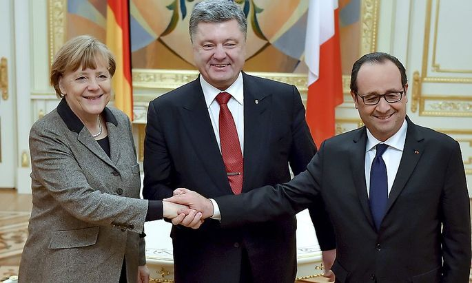 Gipfeltreffen in Kiew: Merkel, Poroschenko, Hollande.
