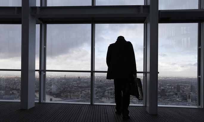 A man looks out from The View gallery at the Shard, western Europe´s tallest building, in London