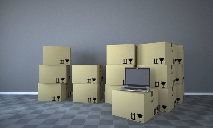 Shipping cartons with notebook in a room 3d rendering PUBLICATIONxINxGERxSUIxAUTxHUNxONLY ALF000429