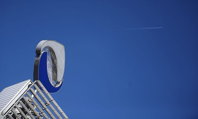 The logo of defunct lender Austrian bank Hypo Alpe Adria stands on the rooftop of its headquarters in Klagenfurt