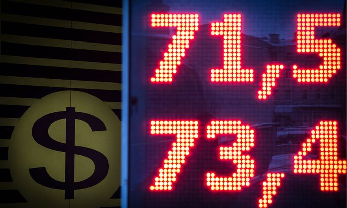 MOSCOW RUSSIA JANUARY 11 2015 A digital information board showing currency exchange rates in a s