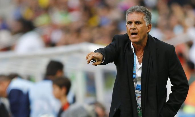 Iran's coach Carlos Queiroz gestures during the 2014 World Cup Group F soccer match between Iran and Nigeria at the Baixada arena