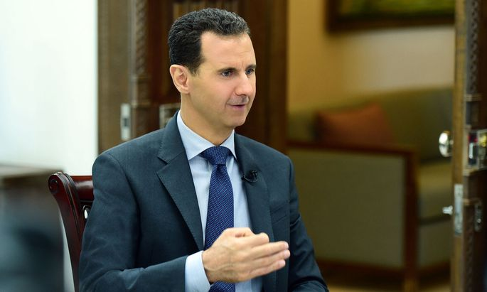 Syria's President Bashar al-Assad speaks during an interview with RIA Novosti and Sputnik