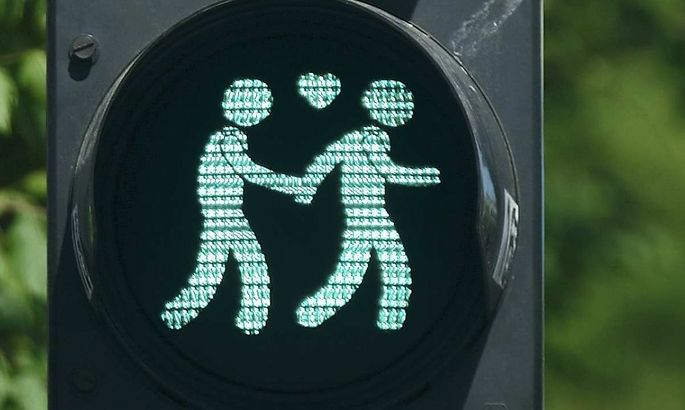 A combination of photos shows gay-themed traffic lights in Vienna