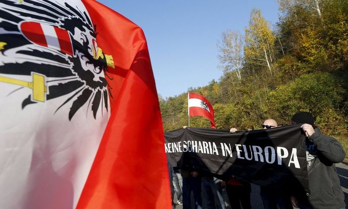 Protesters take part in an anti-migrant rally at the Spielfeld border crossing with Slovenia, in Austria