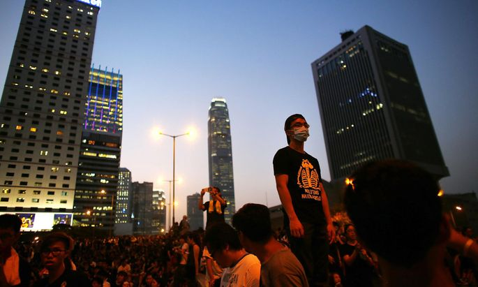 Protesters block the main street to the financial Central district, outside the government headquarters in Hong Kong