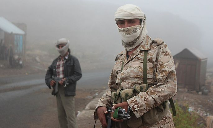 Fighters of the anti-Houthi Popular Resistance Committee secure a highway road linking Yemen's capital Sanaa with southern provinces