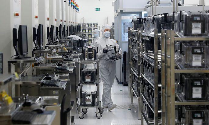 Employees of Austrian sensor specialist AMS work in their factory in Unterpremstaetten