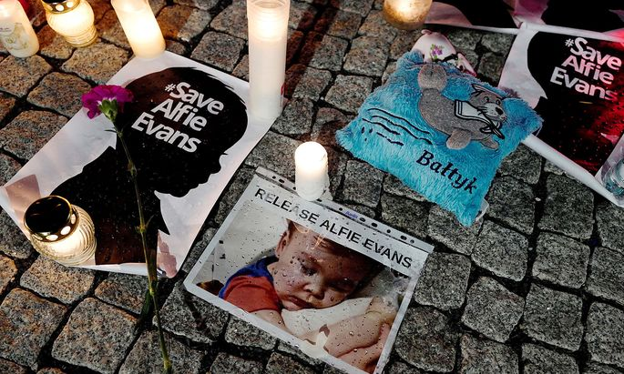 FILE PHOTO: Candles and placards are pictured during a protest in support of Alfie Evans, in front of the British Embassy building in Warsaw