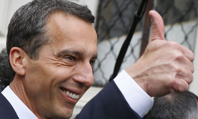 Austrian new Chancellor Kern gives a thumb up as he leaves after the swearing in ceremony in the presidential office in Vienna