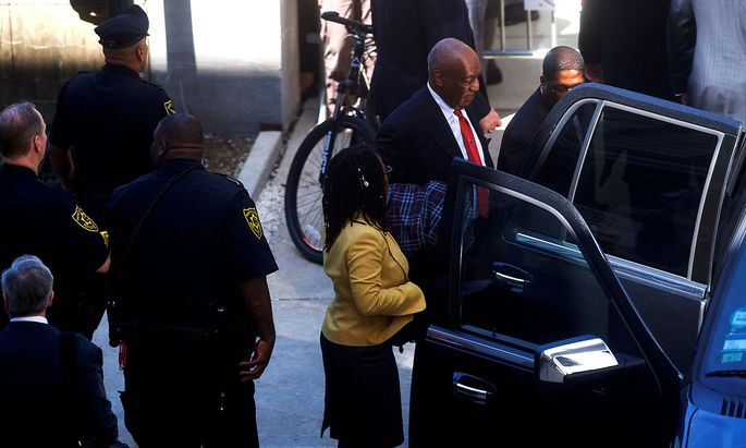 Cosby departs the Montgomery County Courthouse with his publicist, Wyatt, after being found guilty on all counts in his sexual assault retrialin Norristown