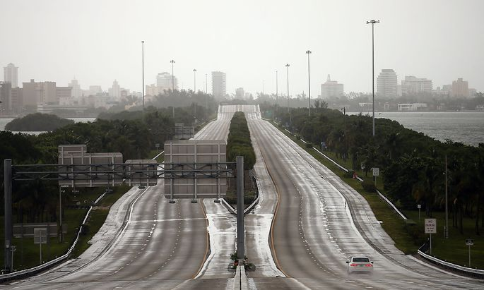A car drives along an empty highway in Miami before the arrival of Hurricane Irma to south Florida
