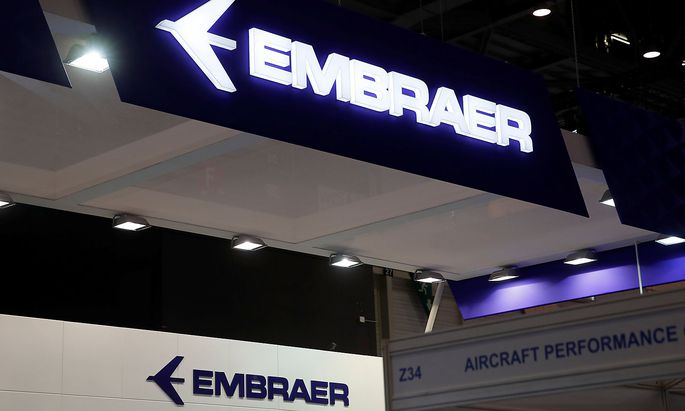 Embraer logos are pictured during EBACE in Geneva
