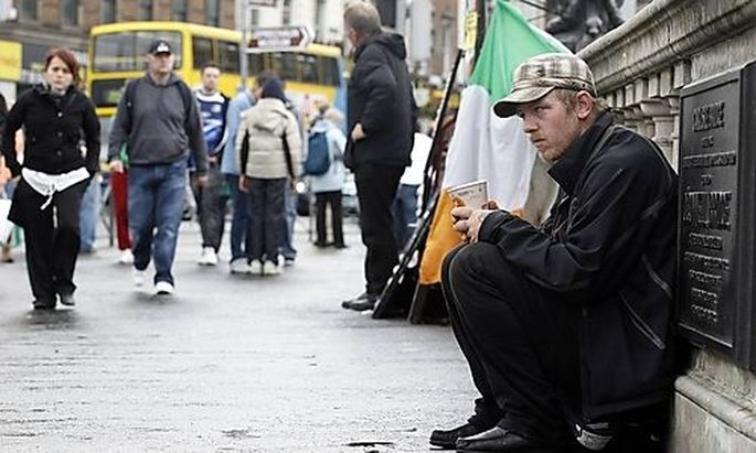 A beggar sits on OConnell Bridge in the centre of DublinConnell Bridge in the centre of Dublin