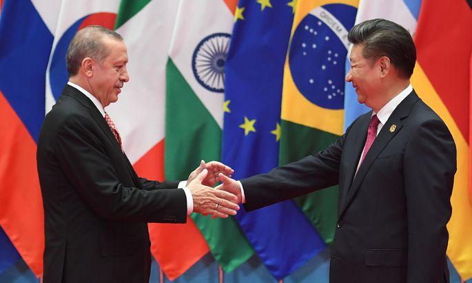 Erdoğan (links) und Chinas Präsident, Xi Jinping.