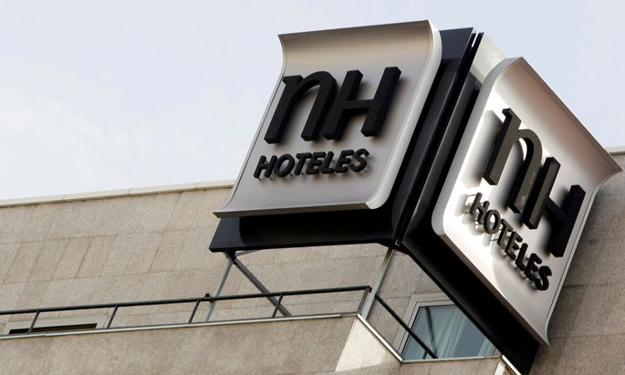 FILE PHOTO: The logo of Spanish NH Hoteles chain is seen on the roof of one of its hotel in central Madrid