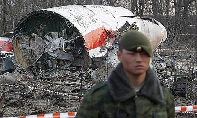 File photo of Russian serviceman standing guard near part of the wreckage of a Polish government Tupo