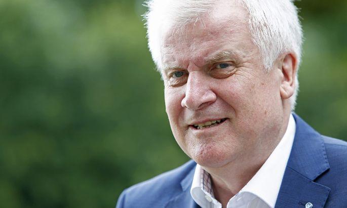 Bavarian state premier Seehofer arrives for news conference in Sankt Quirin
