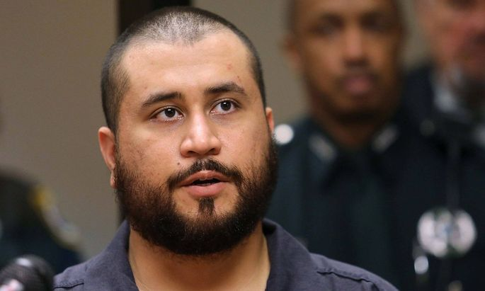 Nov. 19, 2013 - Sanford, FL, USA - George Zimmerman, the acquitted shooter in the death of Trayvon Martin, answers ques
