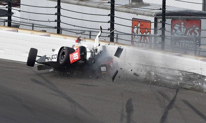 Indy Car driver Sebastien Bourdais slams the turn 2 wall during qualifications at the Indianapolis M