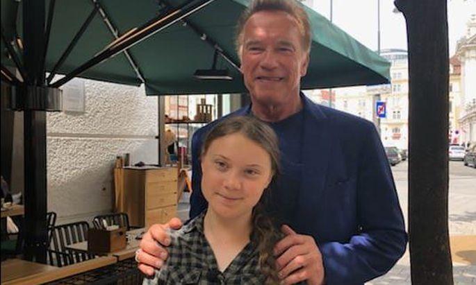 Arnold Schwarzenegger und Greta Thunberg.
