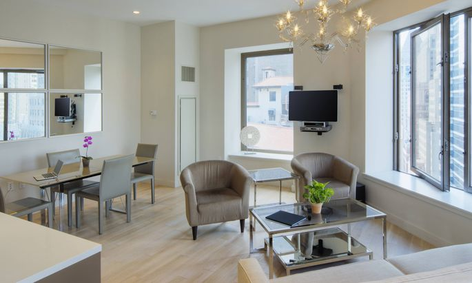 Dining table and armchairs in urban apartment Dining table and armchairs in urban apartment New York