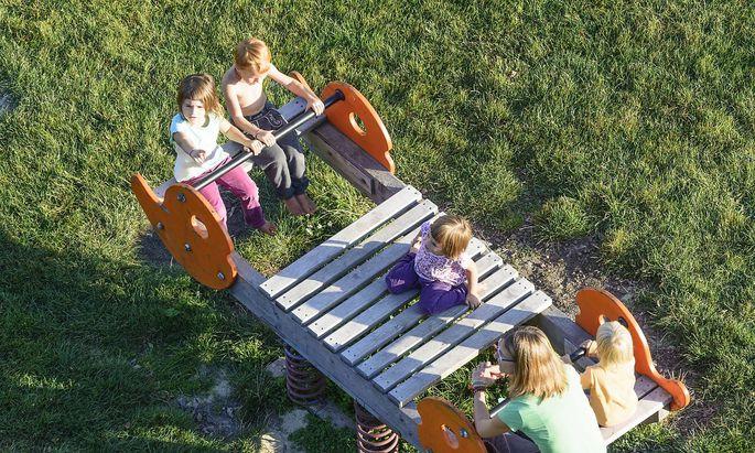 kids at swing at playground in Neulengbach Wienerwald Vienna Woods Nieder�sterreich Lower Austri