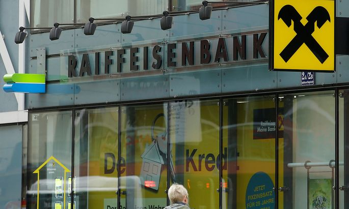 FILE PHOTO: The logo of Raiffeisen Bank International is seen at a branch office in Vienna