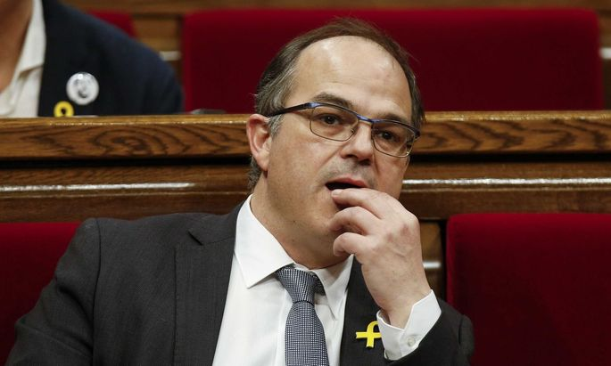 Catalan regional deputy Turull gestures during an investiture debate at Catalonia's regional parliament in Barcelona