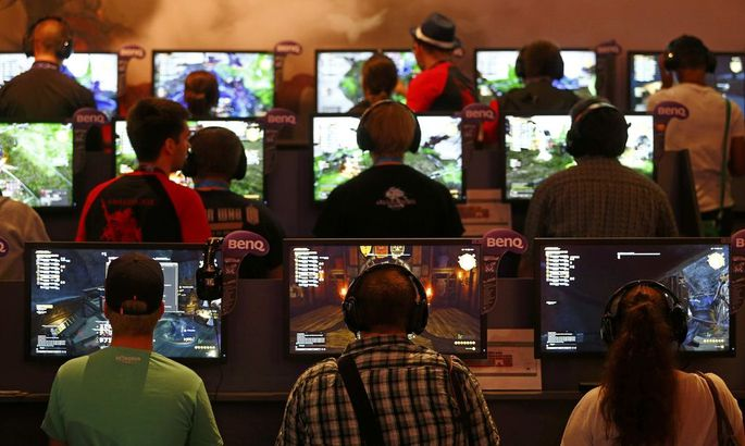 Gamers play the ´Final Fantasy XIV: Heavensward´ during the Gamescom 2015 fair in Cologne