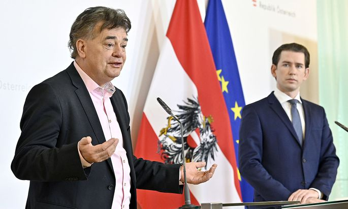 Austrian Chancellor Sebastian Kurz and Vice-Chancellor Werner Kogler attend a news conference as the spread of coronavirus disease (COVID-19) continues in Vienna