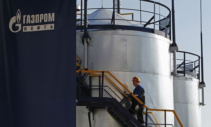 File photo of an employee walking up the stairs at the Gazprom Neft oil refinery in Moscow