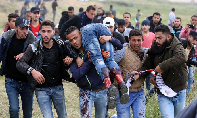 March 30 2018 Gaza City Gaza Strip Palestinian Territory A wounded Palestinian is evacuated d