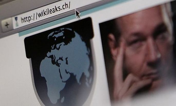 A screen shot of a web browser displaying the WikiLeaks website with a picture of its founder Julian