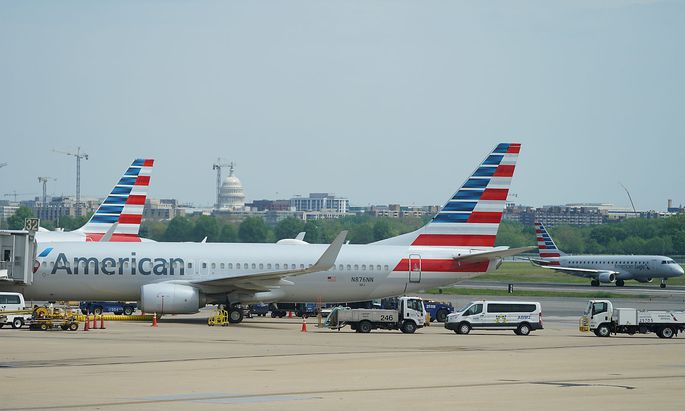 American Airlines Boeing 737 jet sits at a gate at Washington's Reagan National airport