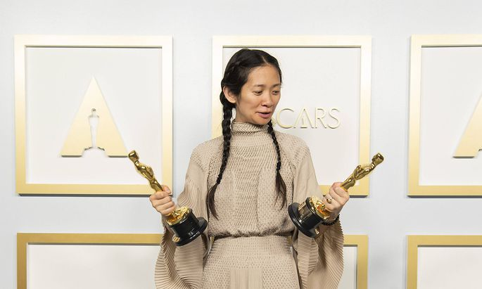 April 25, 2021, Los Angeles, California, USA: Chloà Zhao poses backstage with the Oscars for Directing and Best Picture