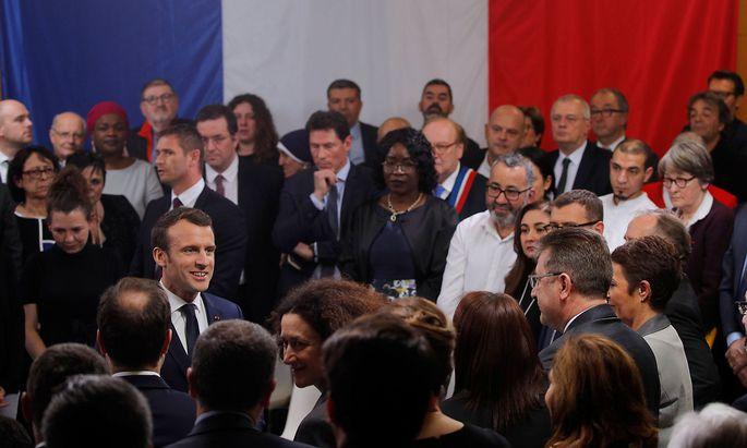 French President Emmanuel Macron attends a meeting with elected officials and local association members as part of the 'Great National Debate' in Evry-Courcouronnes