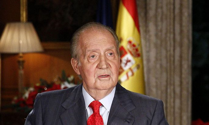 Spanish King Juan Carlos speaks during his traditional Christmas message at Zarzuela Palace in Madrid