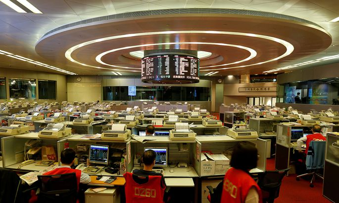 FILE PHOTO: Floor traders at work during the launch of Shenzhen Connect at the Hong Kong Exchanges in Hong Kong