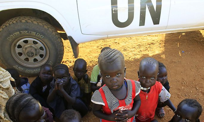 Newly arrived displaced families wait at Tomping United Nations base near Juba international airport