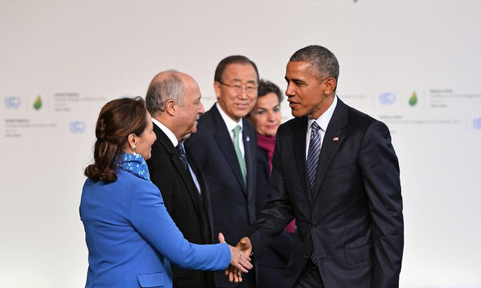 U S President Barack Obama R is greeted by from L to R French Environment Minister Segolene Roy