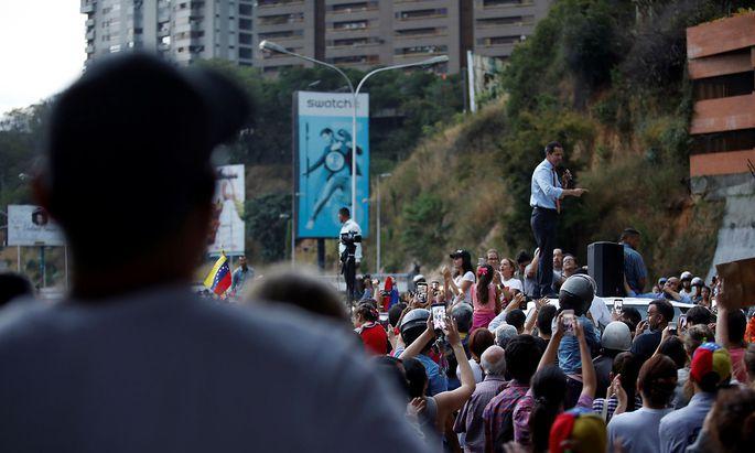 Venezuelan opposition leader Juan Guaido speaks to the crowd during a protest against Venezuelan President Nicolas Maduro's government in Caracas