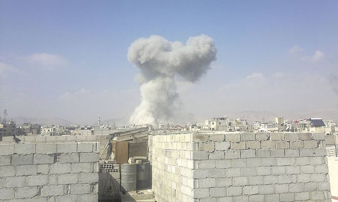 Smoke from what activists say was missile fired by a Syrian Air Force fighter jet loyal to Syria's President Bashar al-Assad is seen at Erbeen