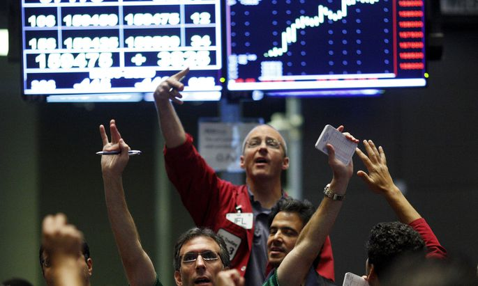 Traders work in the SP 500 Pit at the Chicago Mercantile Exchange