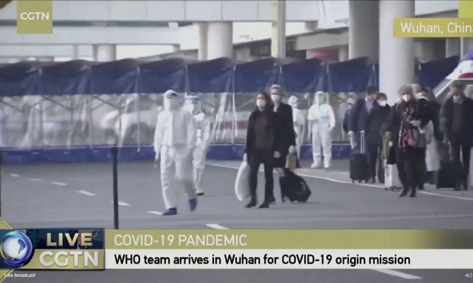 Still image of WHO team tasked with investigating the origins of the coronavirus disease (COVID-19) pandemic arriving at Wuhan Tianhe International Airport