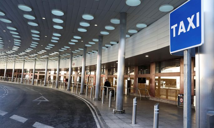 An empty airport taxi stop is seen during a strike by taxi drivers to protest what they say is unfair competition from new car sharing companies such as Uber and Cabify, at the airport in Madrid