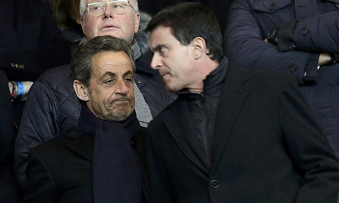 Former French President Sarkozy French Interior Minister Valls and French Interior Minister Valls attend the French Ligue 1 soccer match between Paris Saint-Germain and Olympique Marseille at the Parc des Princes stadium in Paris