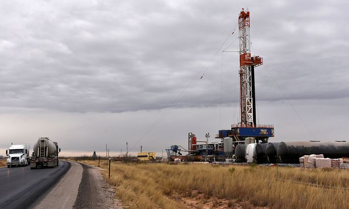 FILE PHOTO: A drilling rig operates in the Permian Basin oil and natural gas producing area in Lea County