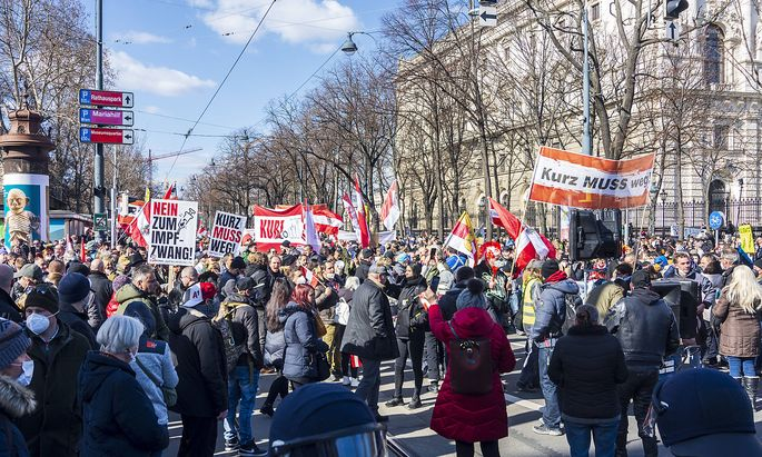 Corona protest demonstration, opponents of the corona measures march, police cordon, at street Burgring Wien, Vienna Wi