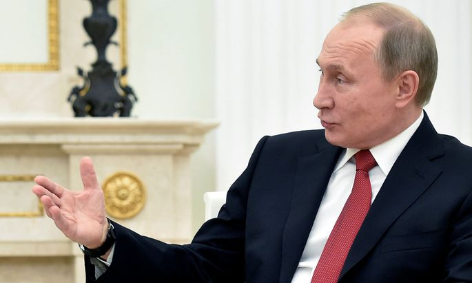 Russian President Putin gestures as he speaks during a meeting with Khadzhimba (not pictured), the leader of Georgia´s breakaway region of Abkhazia, at the Kremlin in Moscow